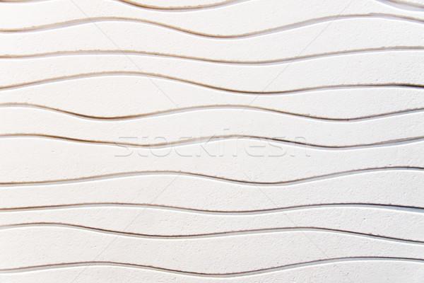 White undulated plaster Stock photo © elxeneize