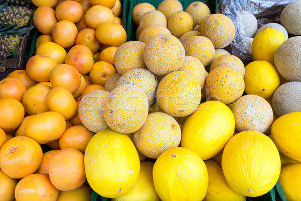 Melons and clementines Stock photo © elxeneize