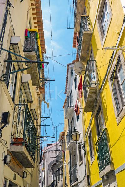 Small narrow street in Lisbon Stock photo © elxeneize