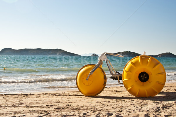 Sarı plaj bisiklet kum okyanus bisiklet Stok fotoğraf © emattil