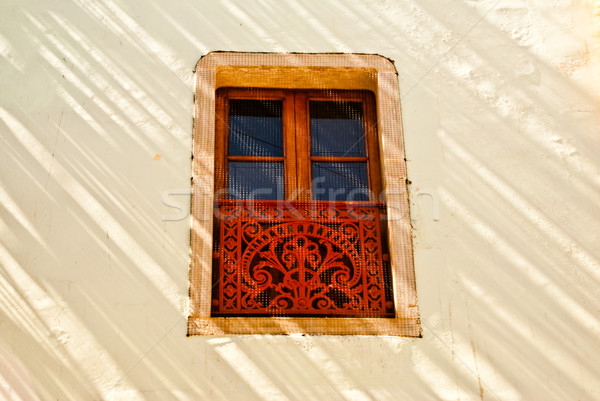 Decorative window in sunlight and shadow Stock photo © emattil