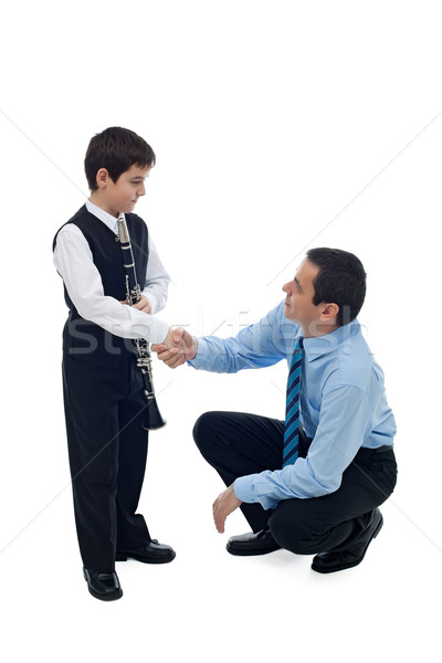 Father shaking hand with his son Stock photo © emese73