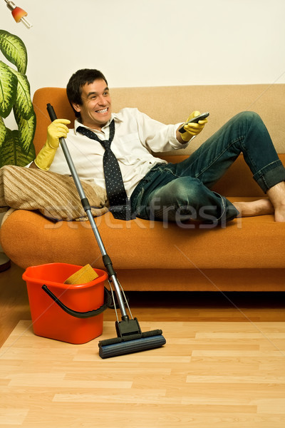 Happy man with mop Stock photo © emese73
