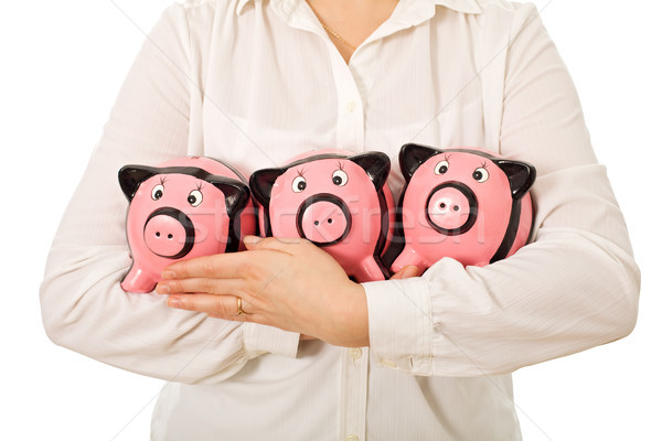 Businesswoman holding piggy-banks Stock photo © emese73