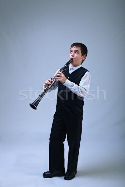 Boy playing on the clarinet Stock photo © emese73