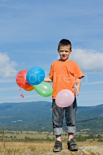 Boy with balloons Stock photo © emese73