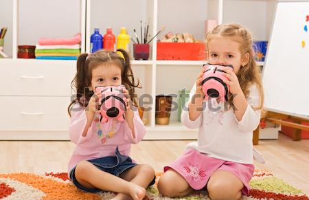 Little girls kissing the piggybanks Stock photo © emese73