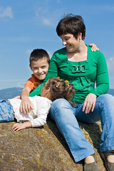 Happy family sitting on the stone Stock photo © emese73