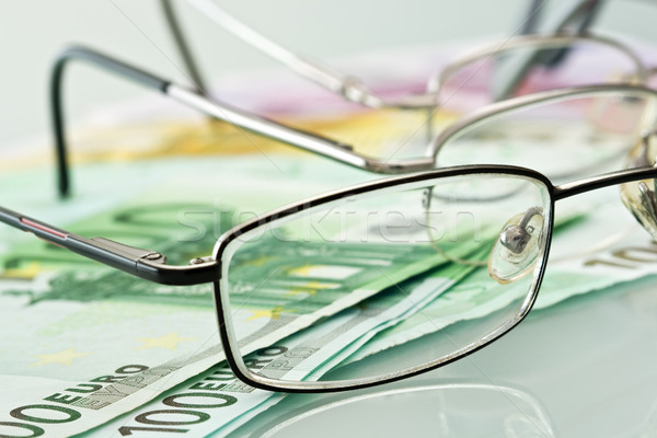 Eyeglasses and currencies Stock photo © emese73