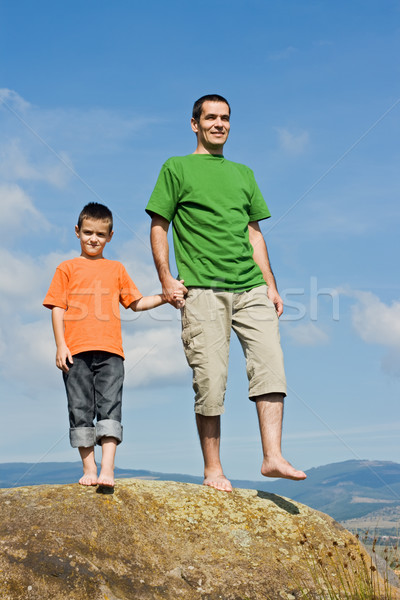 Happy family standing on the stone Stock photo © emese73