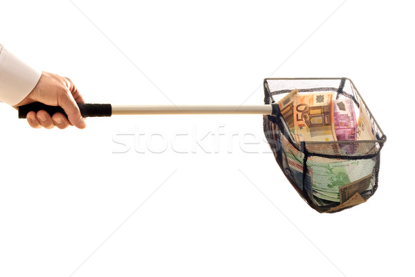 Businessman with net and money Stock photo © emese73