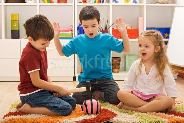 Children playing with a piggybank Stock photo © emese73