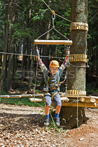 Happy boy in the adventure park Stock photo © emese73