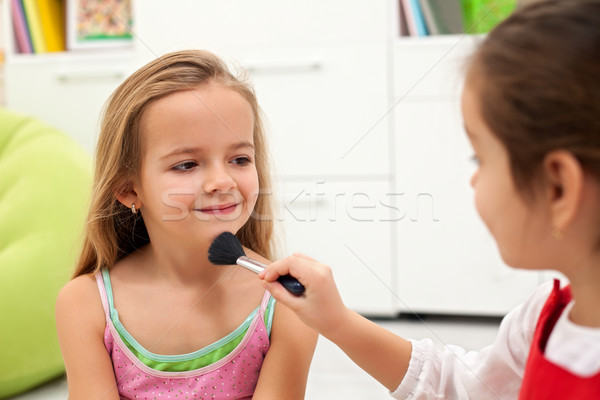 Applying powder on face Stock photo © emese73