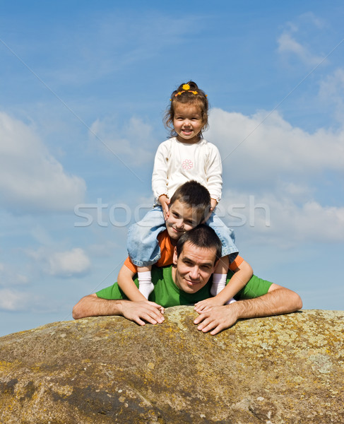 Happy family leaning on the stone Stock photo © emese73
