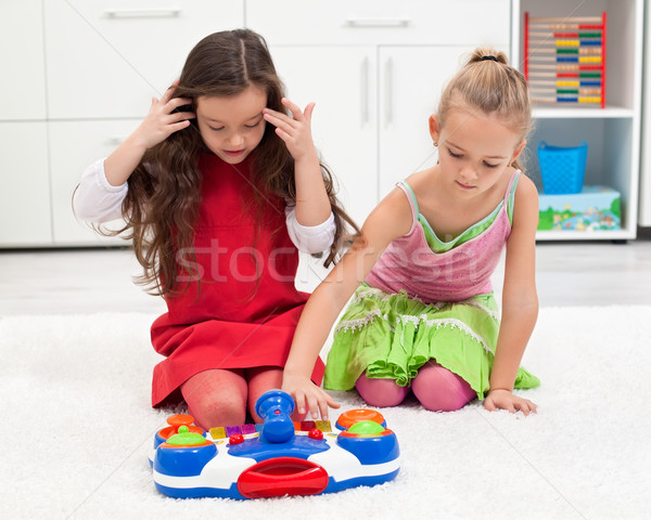Little girls playing on the floor Stock photo © emese73