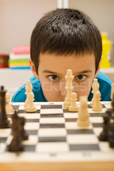 Boy playing chess Stock photo © emese73