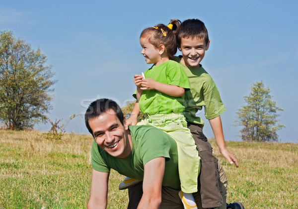 Happy family playing on the meadow Stock photo © emese73
