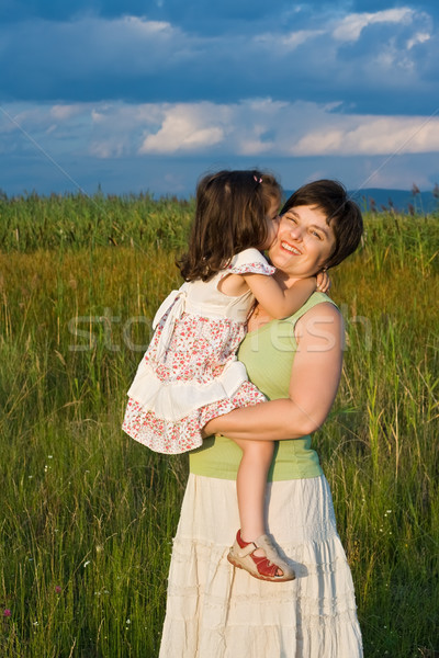 Little girl and her mother staying outside Stock photo © emese73