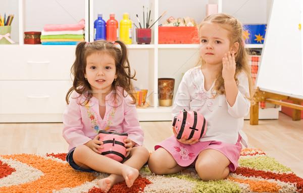 Little girls holding piggybanks Stock photo © emese73
