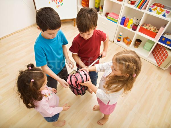 Children playing with piggybanks Stock photo © emese73