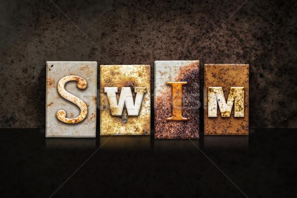 Swim Letterpress Concept on Dark Background Stock photo © enterlinedesign