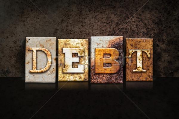 Debt Letterpress Concept on Dark Background Stock photo © enterlinedesign