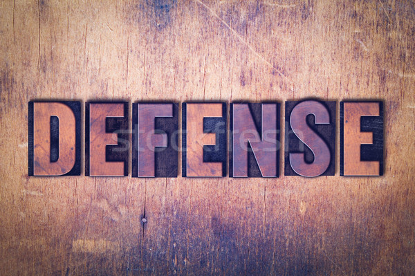 Defense Theme Letterpress Word on Wood Background Stock photo © enterlinedesign