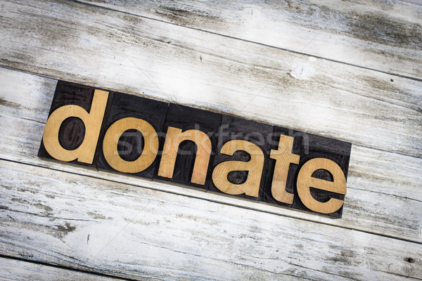 Donate Letterpress Word on Wooden Background Stock photo © enterlinedesign