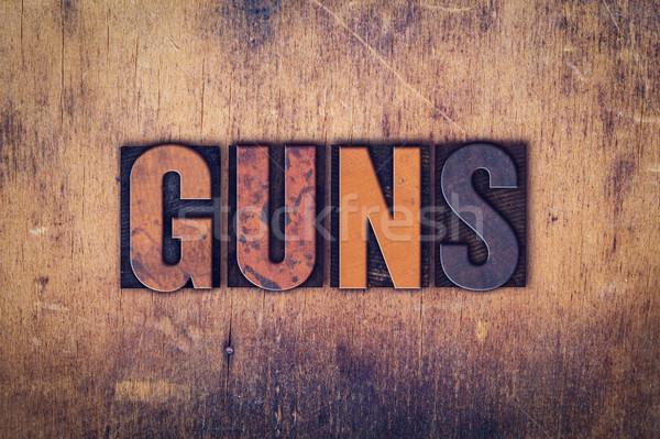 Guns Concept Wooden Letterpress Type Stock photo © enterlinedesign