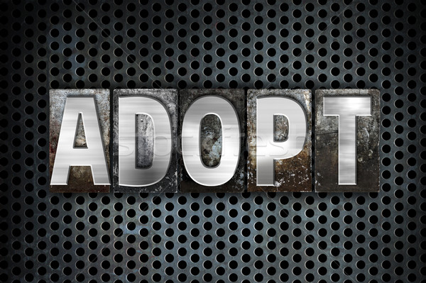 Adopt Concept Metal Letterpress Type Stock photo © enterlinedesign