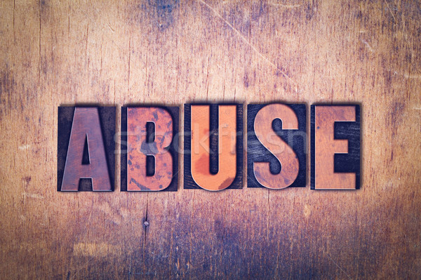 Abuse Theme Letterpress Word on Wood Background Stock photo © enterlinedesign