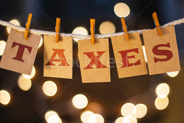 Stock photo: Taxes Concept Clipped Cards and Lights