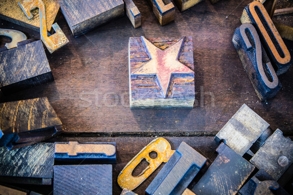 Vintage Letterpress Star with Numbers and Letters Stock photo © enterlinedesign