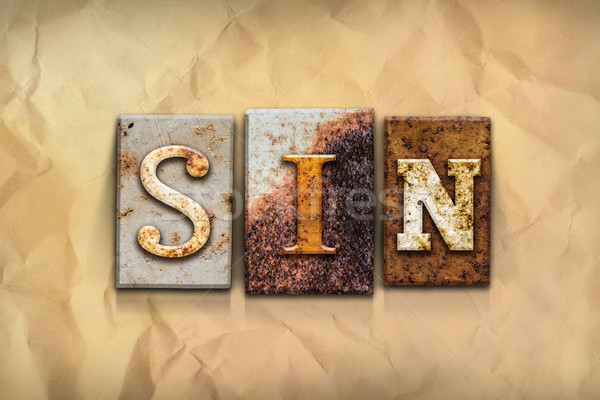 Sin Concept Rusted Metal Type Stock photo © enterlinedesign