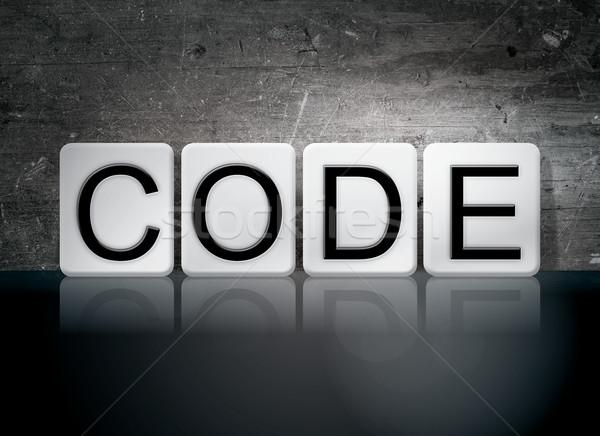 Kod kiremitli harfler kelime yazılı beyaz Stok fotoğraf © enterlinedesign