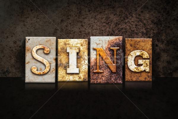 Sing Letterpress Concept on Dark Background Stock photo © enterlinedesign