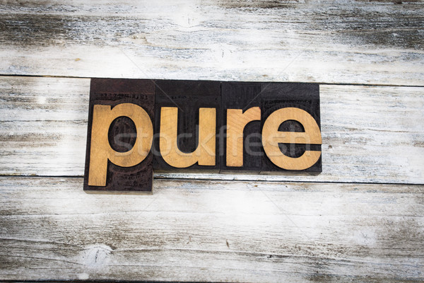 Pure Letterpress Word on Wooden Background Stock photo © enterlinedesign