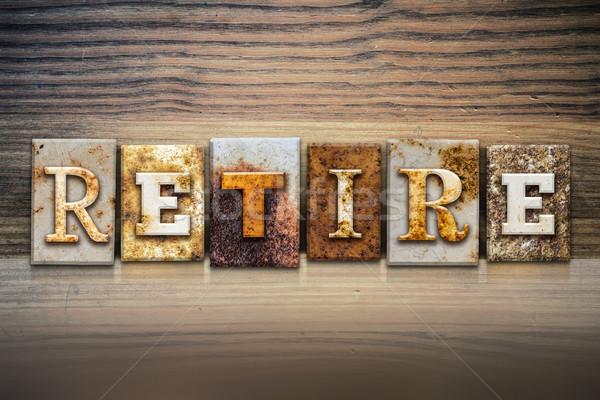 Andare in pensione parola scritto arrugginito metal Foto d'archivio © enterlinedesign