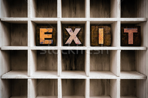 Exit Concept Wooden Letterpress Type in Draw Stock photo © enterlinedesign