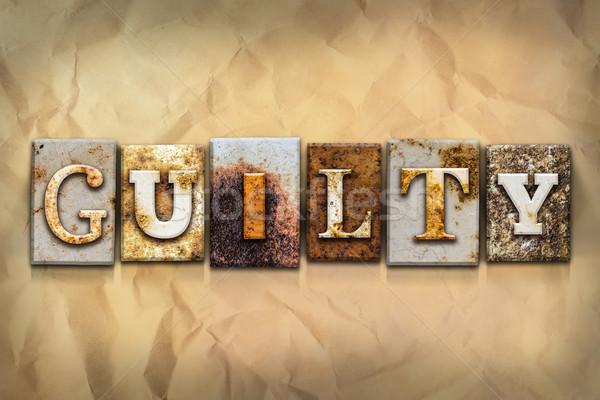 Schuldig metaal type woord geschreven Stockfoto © enterlinedesign