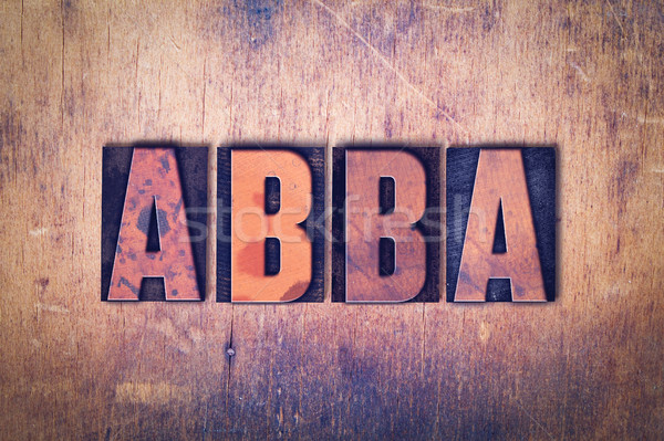 Abba Theme Letterpress Word on Wood Background Stock photo © enterlinedesign