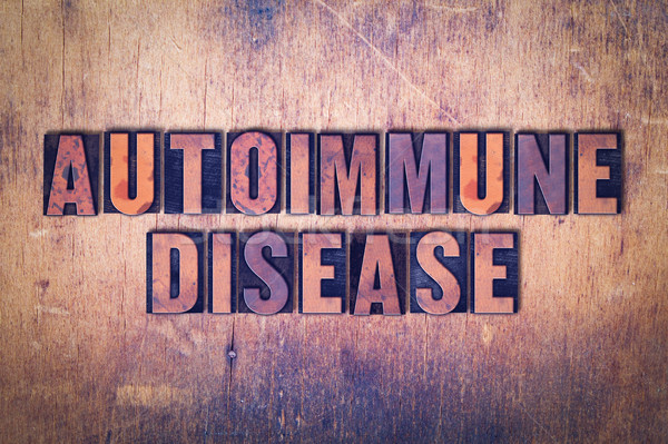 Autoimmune Disease Theme Letterpress Word on Wood Background Stock photo © enterlinedesign