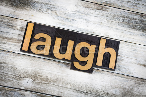 Laugh Letterpress Word on Wooden Background Stock photo © enterlinedesign