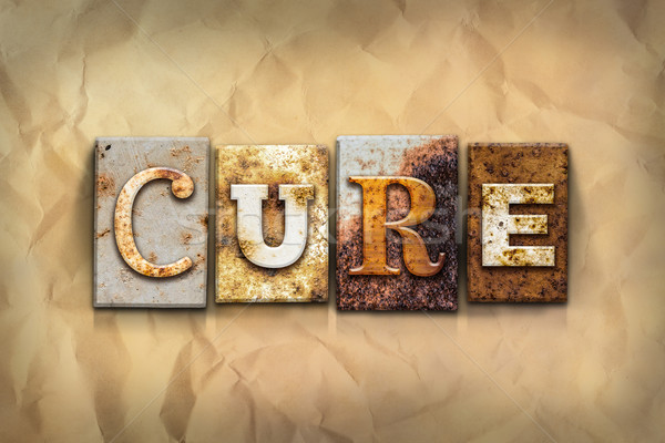 Cure Concept Rusted Metal Type Stock photo © enterlinedesign
