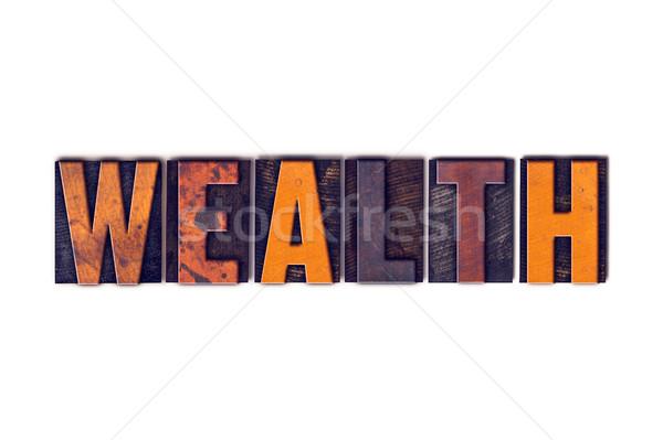 Reichtum isoliert Buchdruck Typ Wort geschrieben Stock foto © enterlinedesign