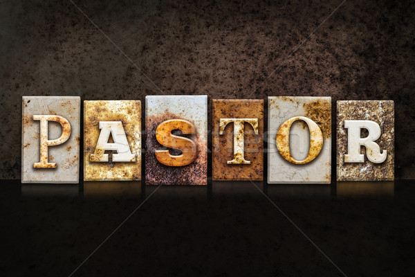 Pastor Letterpress Concept on Dark Background Stock photo © enterlinedesign