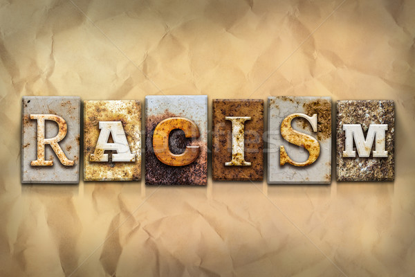 Racism Concept Rusted Metal Type Stock photo © enterlinedesign