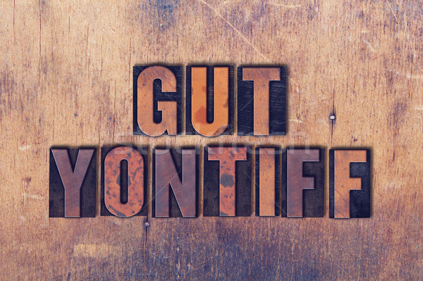 Gut Yontiff Theme Letterpress Word on Wood Background Stock photo © enterlinedesign