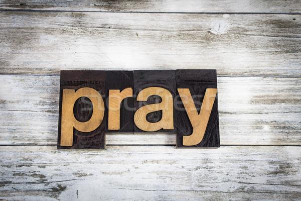Pray Letterpress Word on Wooden Background Stock photo © enterlinedesign